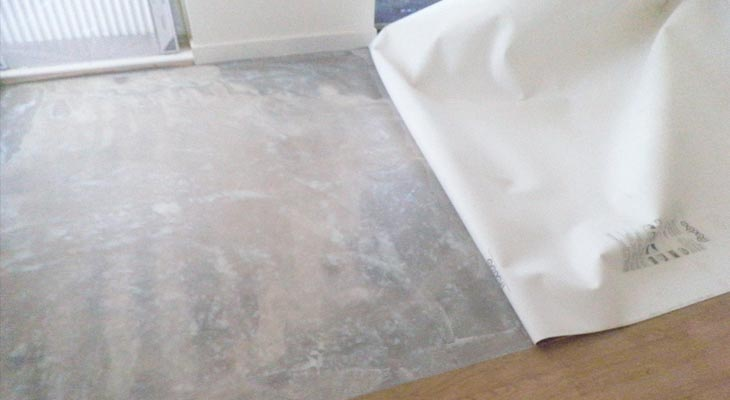 Apply glue ready to receive cushion vinyl flooring