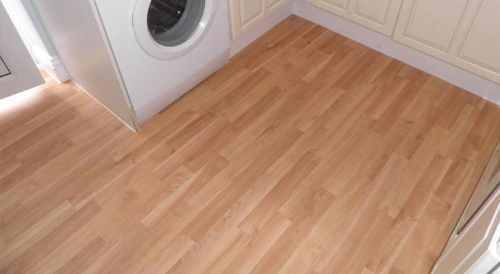 Vinyl cushion flooring installed in kitchen
