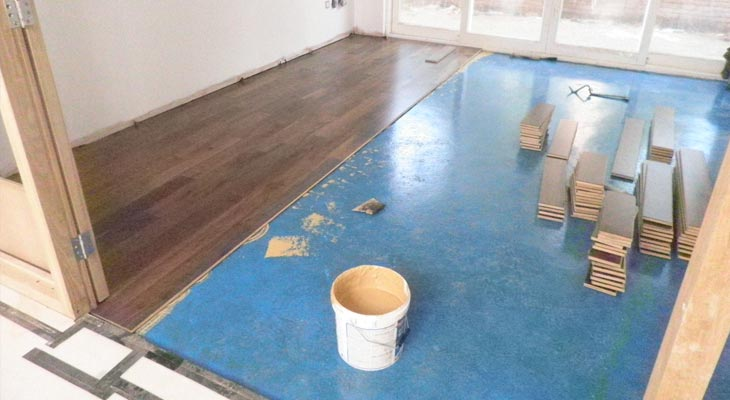 Walnut engineered flooring installation in progress