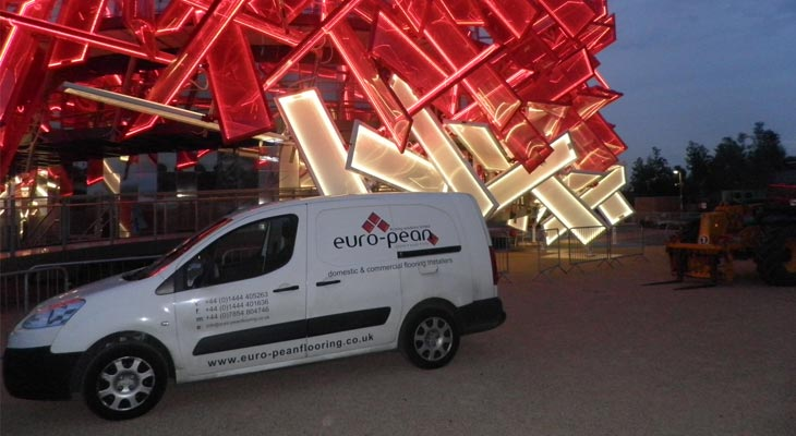 Euro-pean flooring van in front of the finished product