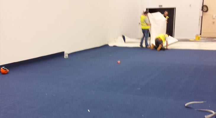 Our Horsham flooring experts laying carpet
