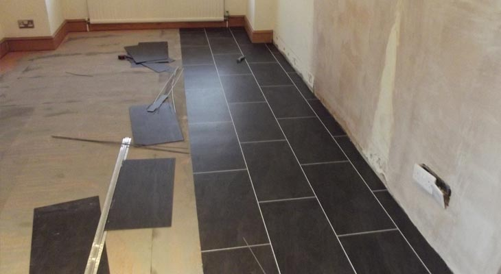 Black and white Amtico vinyl tiles with a white grout line