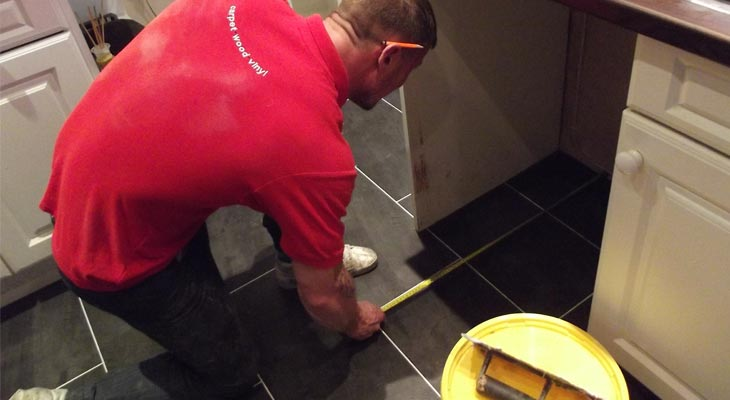 Our Horsham flooring experts measuring the last tile