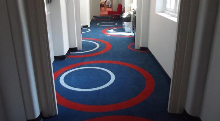 Blue school corridor carpet.