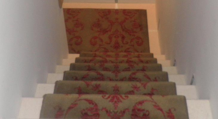 Brintons stair runner fitted to travertine staircase.
