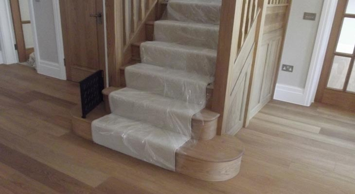Twist pile carpet stair runner.