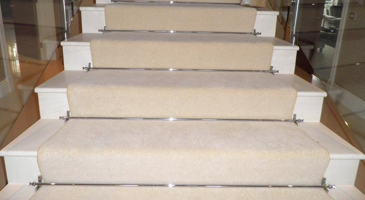 Cobham stair runner fitted with chrome stair rods.
