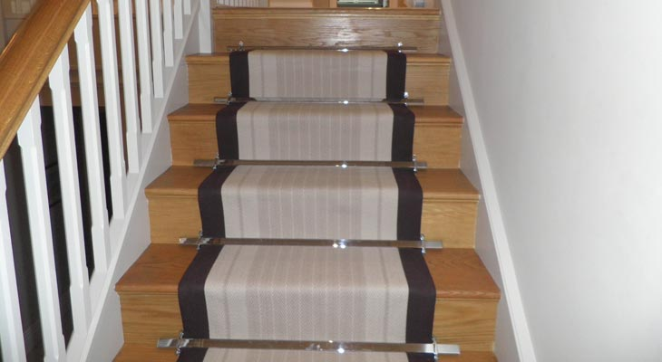 Hartley and Tissier flatweave carpet stair runner.