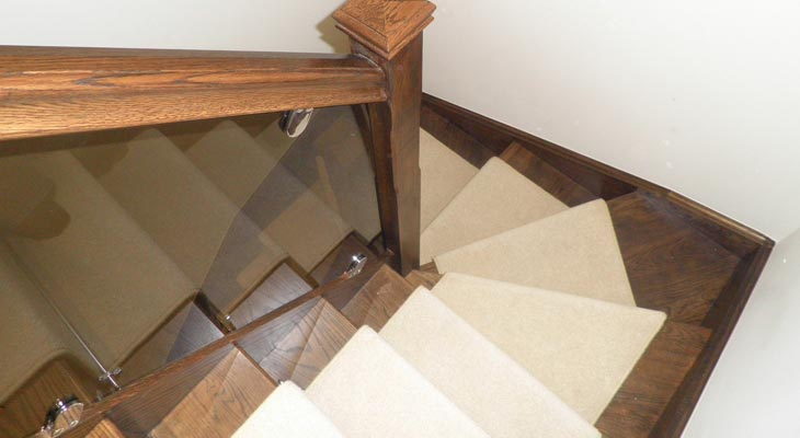 Cream winder section of twist pile stair runner.