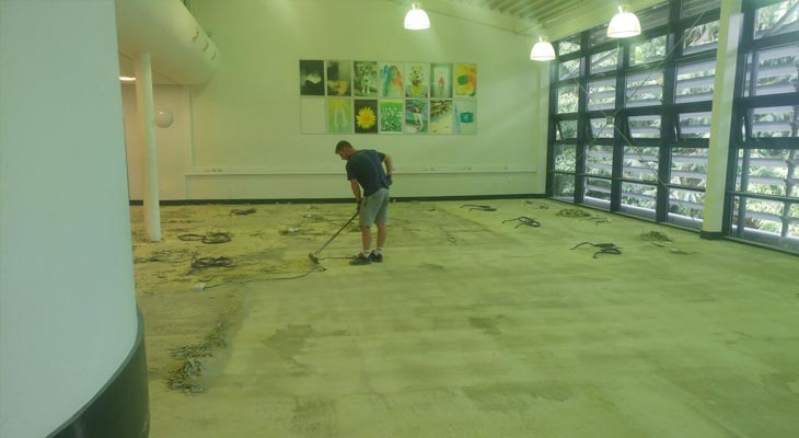 Sweeping up latex fragments after using a mechanical chisel