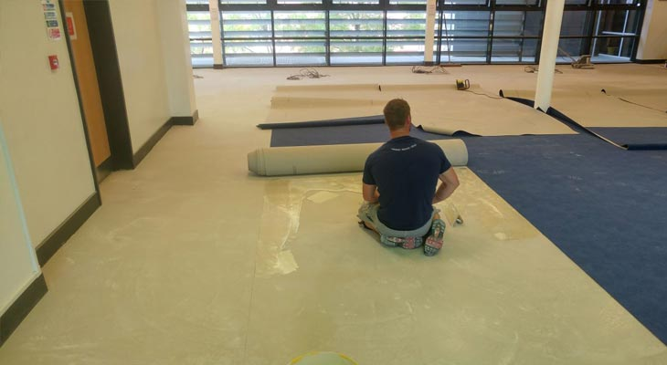Gluing out in front of the carpet roll