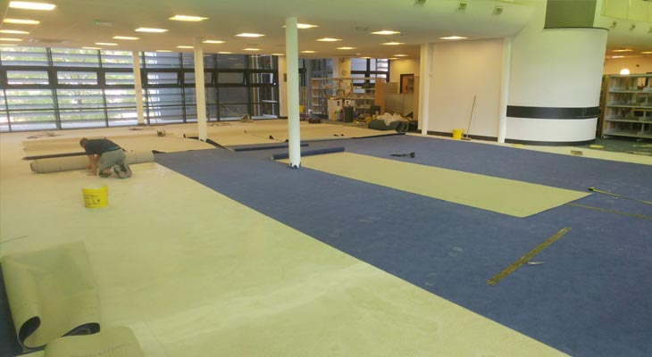 Laying library carpet out from the room centre