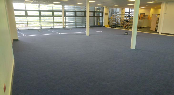Newly installed super hard wearing blue flotex carpet library flooring