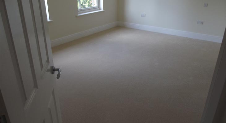 Bedroom with new cream carpet fitted in Surrey