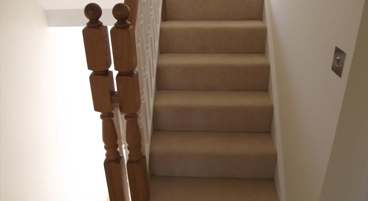 One continuous piece of carpet coming down the stairs