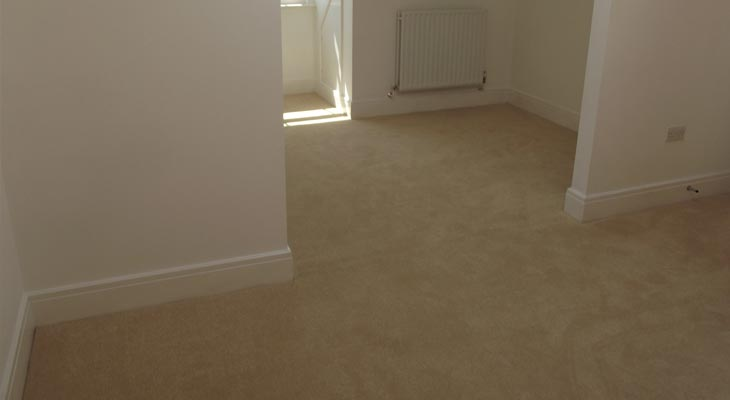 Seamless carpet join to the eaves in one of the bedrooms