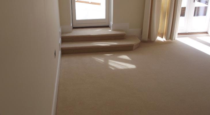 Living room with a new cream velvet carpet fitted