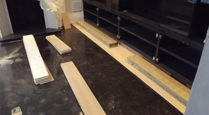 Oak flooring being laid over damp proof membrane