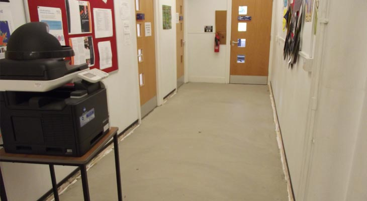 Latex installed over old terrazzo floor in the college corridor