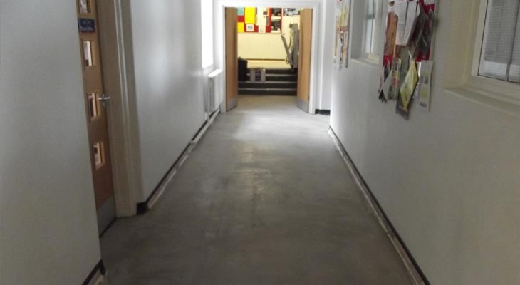 College corridor with new latex layer installed, stairs and disabled lift in the background