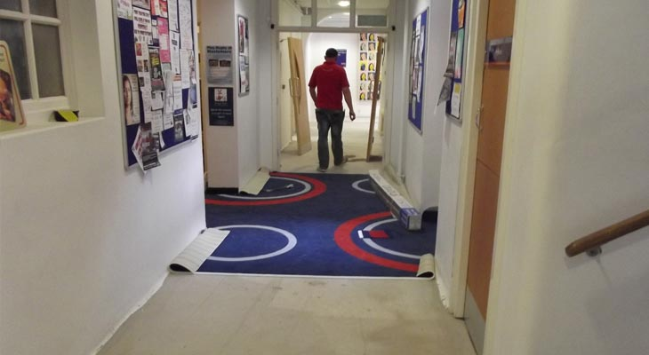 Fitting new college carpet with bespoke pattern to the corridors at Godalming College