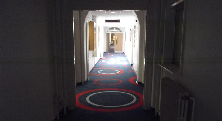 A view along one of the lengthy Godalming college corridors with finished carpet installation by Euro-Pean Flooring in Horsham