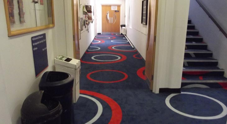 Completed corridor and stairs continuing the bespoke flooring pattern